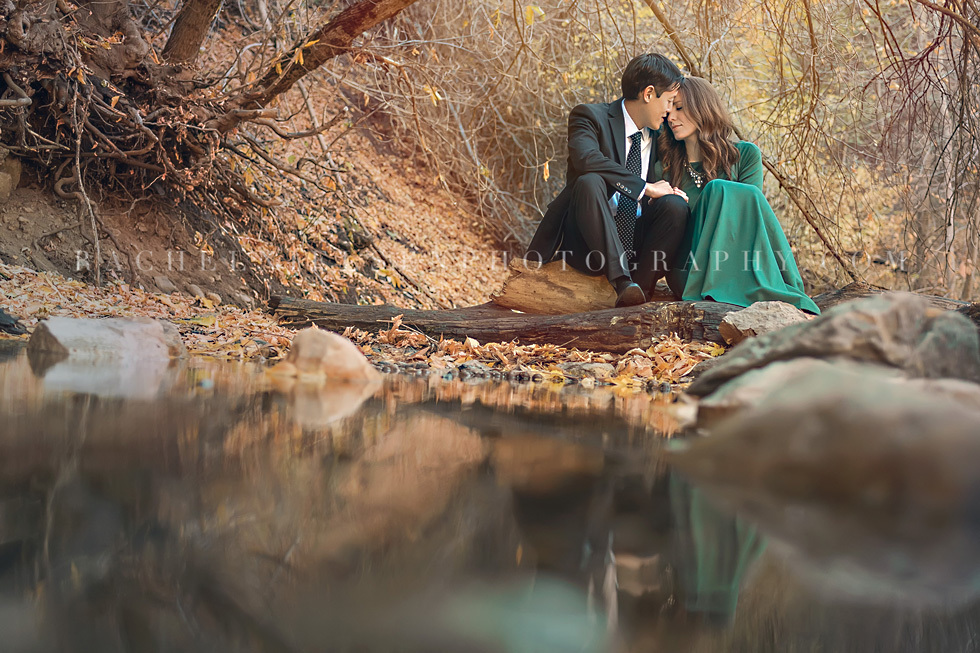 photo of a couple sitting by the water by Rachel Nielsen