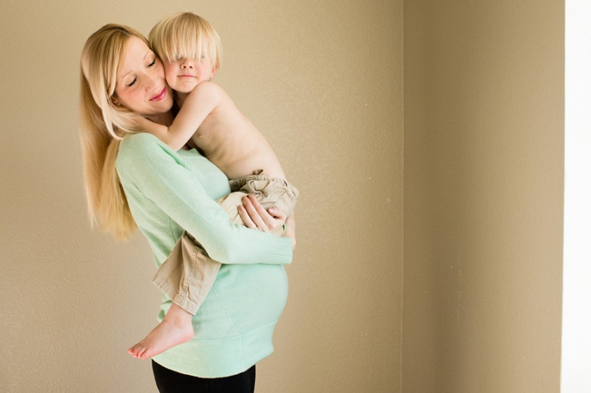 hug from son to expecting mother picture