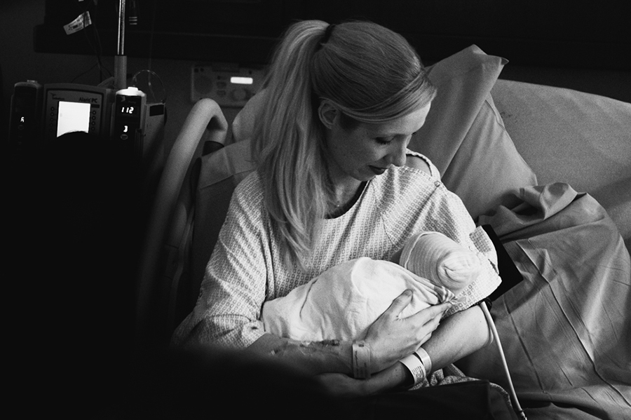 mother holding new baby in hospital photo