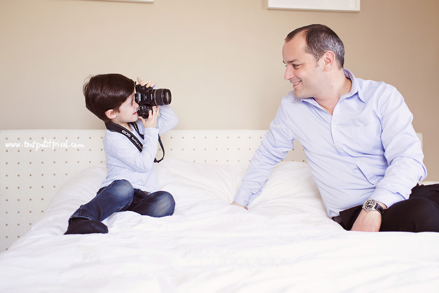 photo of child taking a picture of dad by Lisa Tichane