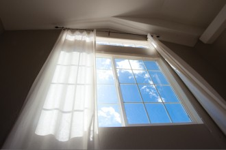 photo of window and curtains by Sarah Wilkerson