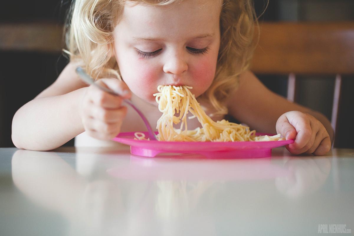 kid eating noodles by April Nienhuis