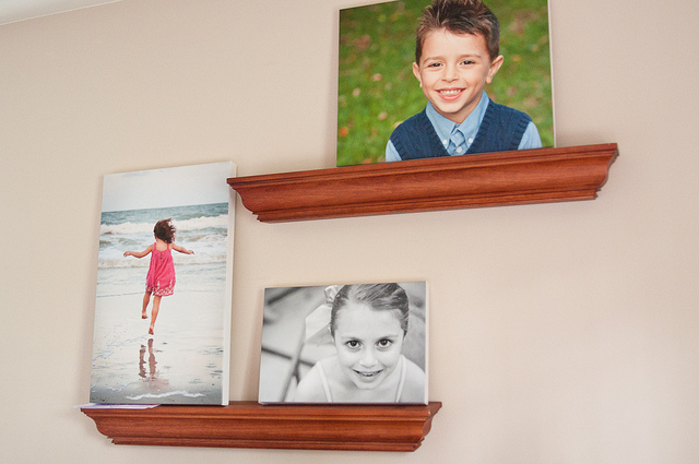 displaying photos on wall ledges
