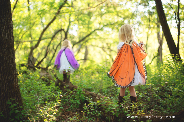 twin girls wearing butterfly wings by Amy Lucy Lockheart