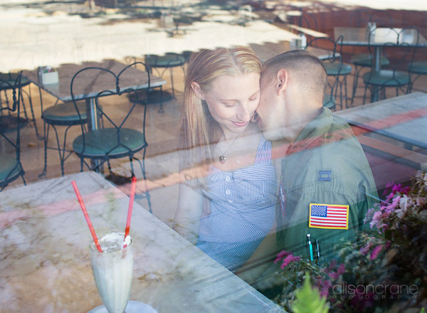 couple photography through glass by Alison Crane