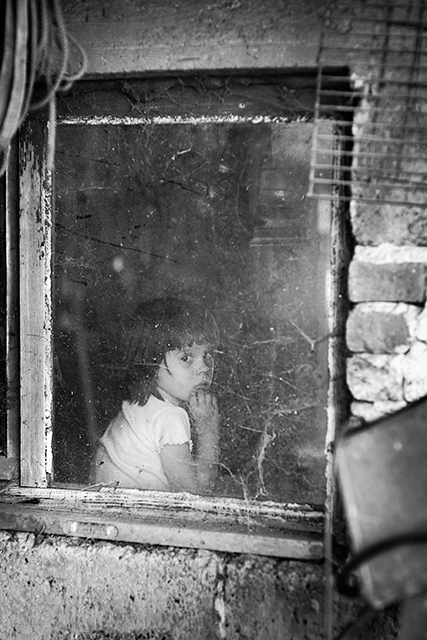 black and white child photography through glass by skoia