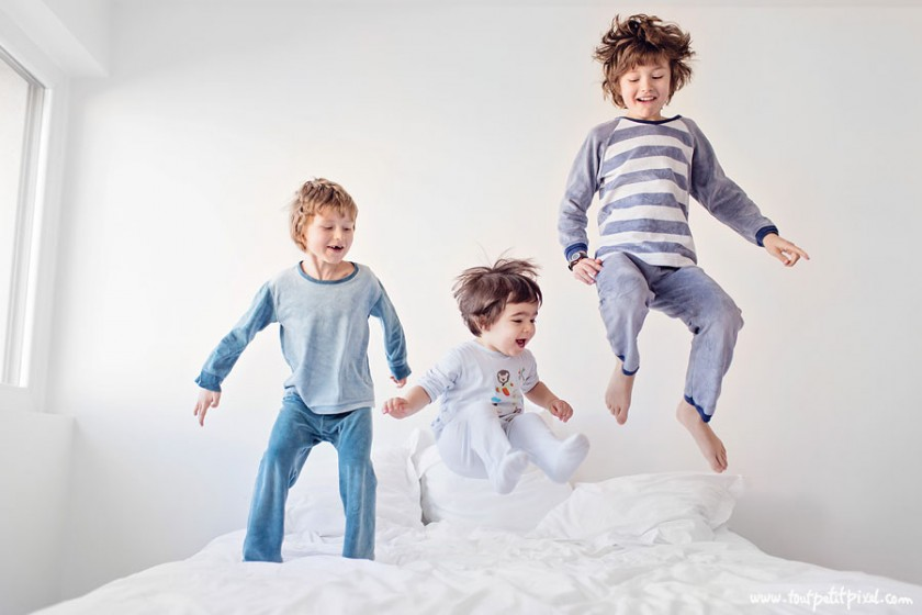 boys jumping on bed photo by Lisa Tichane