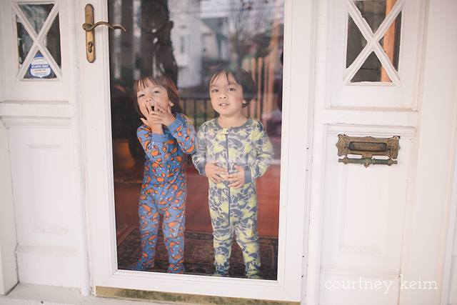 twins saying goobye at the front door