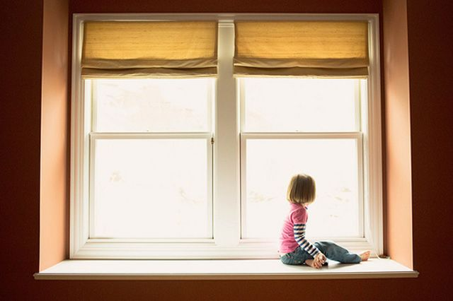 child framed in backlit window photograph by Addie Sheahin