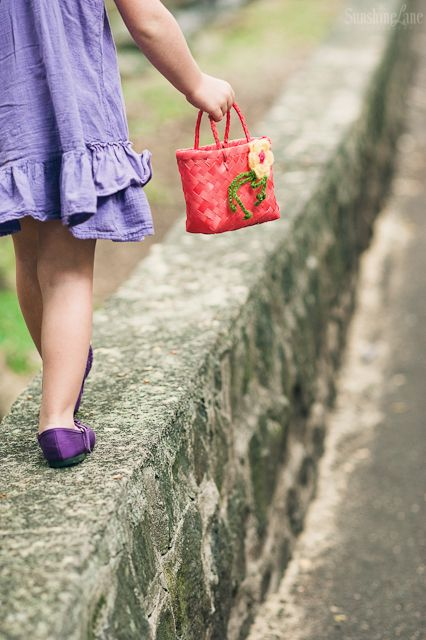 child walking with purse photograph by Sarah Vaughn