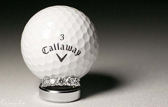 wedding rings on a golf ball detail photograph by Anita Martin