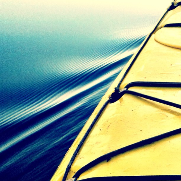 yellow kayak in water instagram photo by pbl_photography
