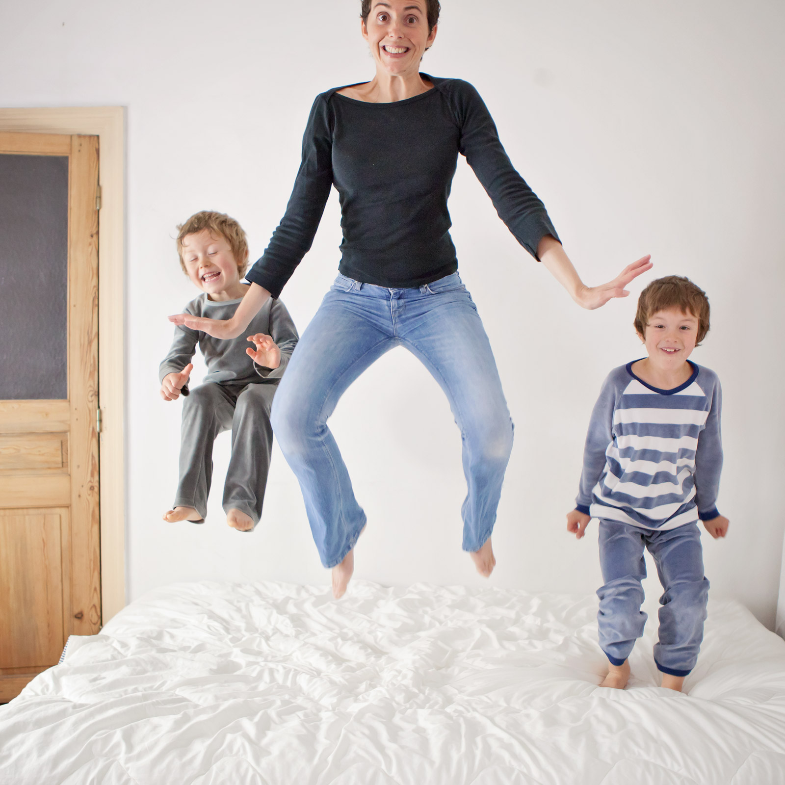 And one of my favorite tricks to get big smiles and belly laughs during a kids photo shoot is definitely the jumping-on-the-bed one.