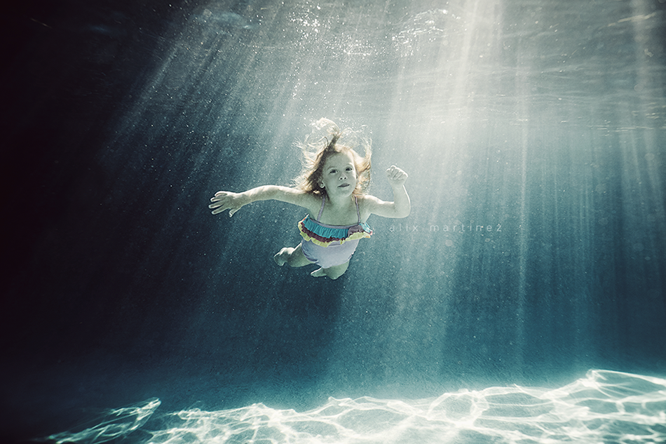 floating in the rays swimming photograph by Alix Martinez