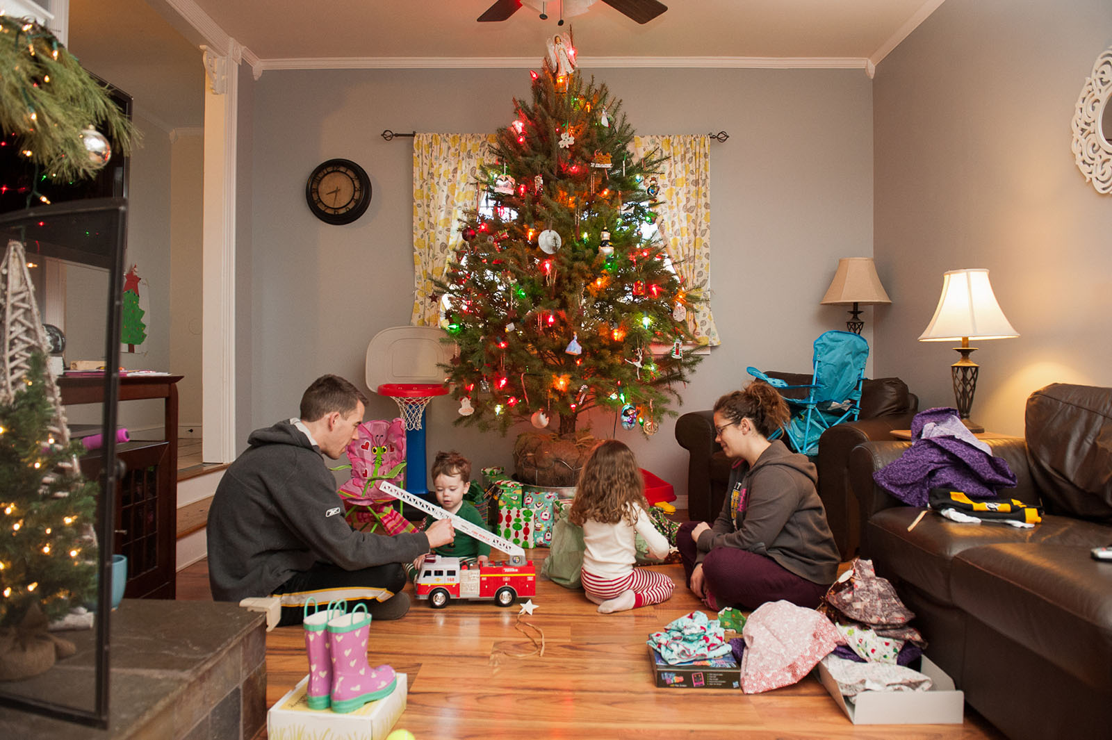 picture of family opening Christmas presents by Melissa Stottmann