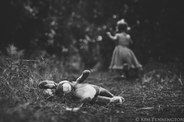 run black and white child photograph with stuffed bunny by Kim Pennington
