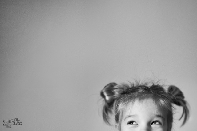 smiling eyes black and white child photograph by Kellie Bieser of Shutter and Glass
