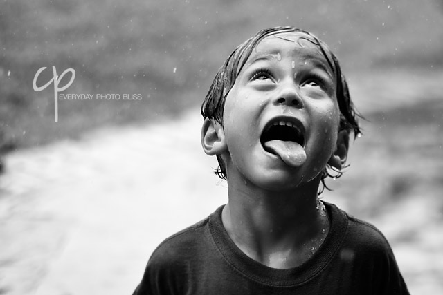 playing in the rain black and white photograph by mommaceleste