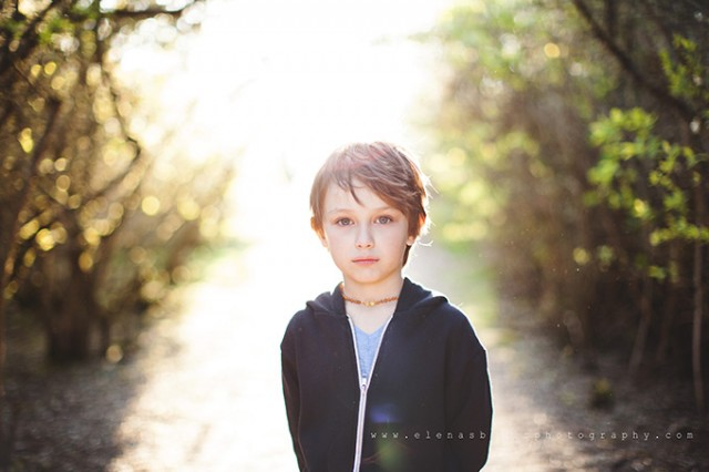 backlit picture of child by Elena Blair