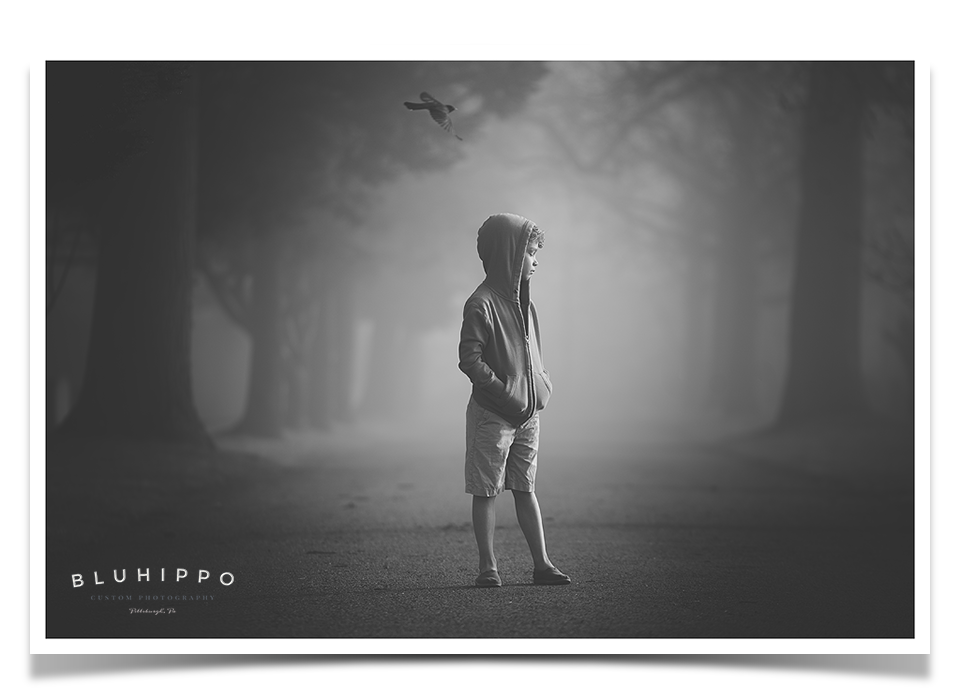 black and white child picture in fog