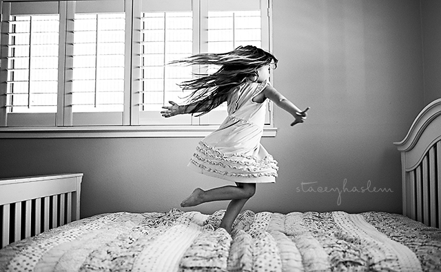 child twirling on bed pic by StaceyHaslem