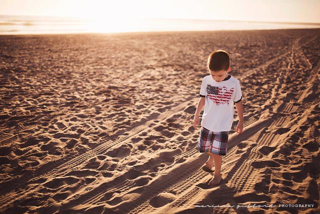 child walking on beach by Marissa Gifford