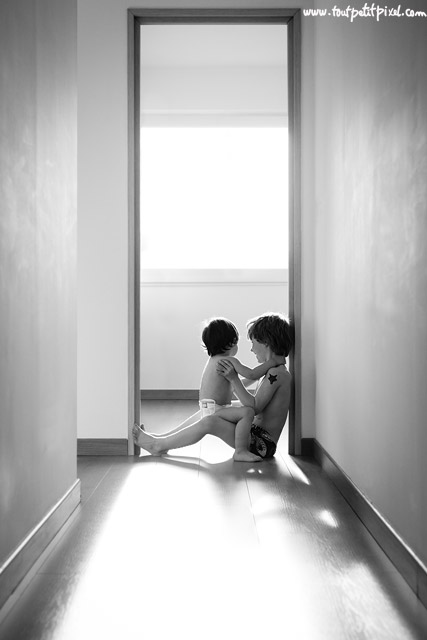 happy boys playing in front of window by Lisa Tichane Tout Petit Pixel
