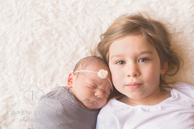 newborn and sibling photo by Karen Linton
