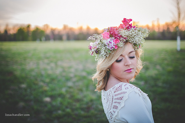 woman wearing crown of flowers by Lissa Chandler