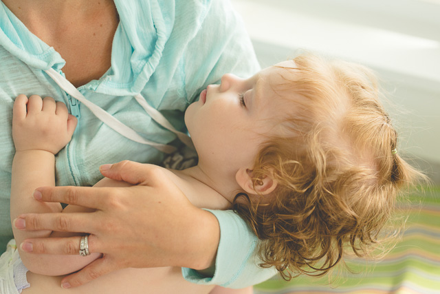 child sleeping in moms arms by Kristy Dooley