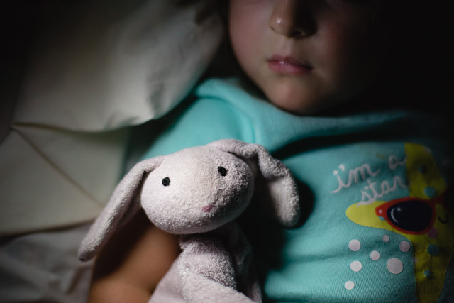 child sleeping with stuffed bunny pic by Kristy Dooley
