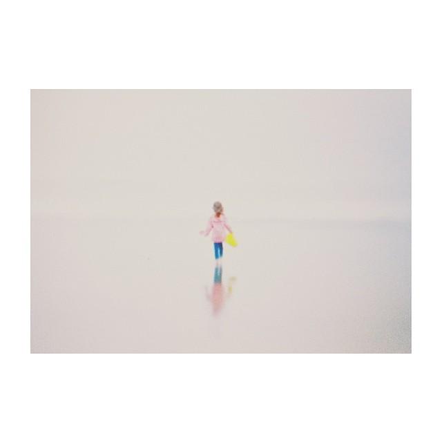 child walking on beach instagram picture by kirafaris