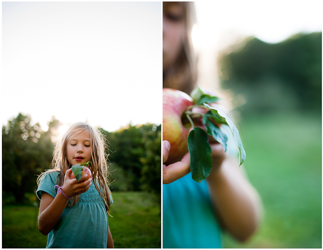girl holding fresh picked fruit photo by Roxanne Bryant Photography