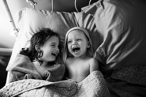 kids laughing photo in black and white by kariliane30