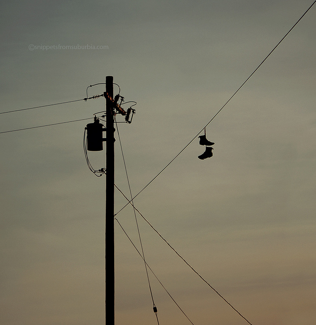 shoes on a telephone wire photograph by Allison Zercher