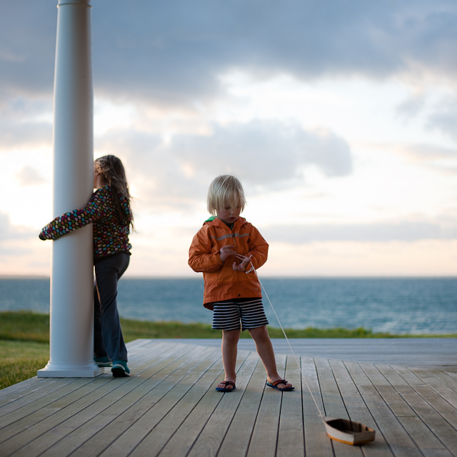 siblings on porch by beach by Roxanne Bryant Photography