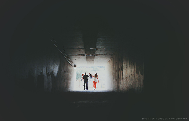 backlit family portrait in tunnel by Summer Murdock
