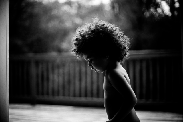 black and white photo of child by Ana Myer
