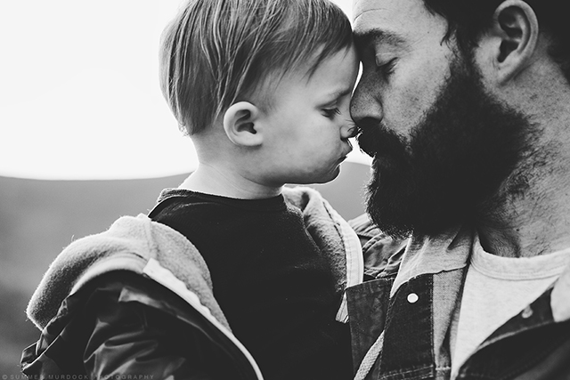 black and white photo of father and son by Summer Murdock