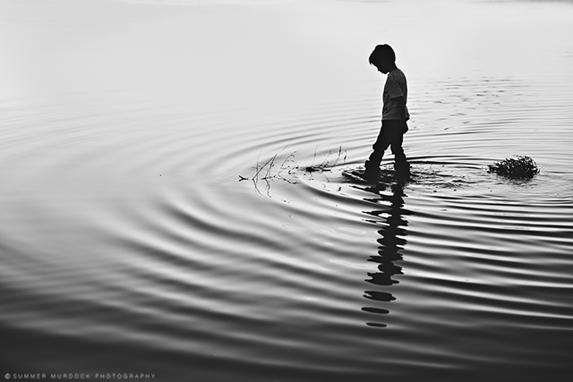 boy playing in water ripples pic by Summer Murdock