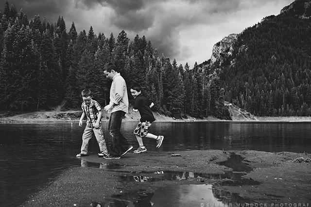 boys walking through water puddles photo by Summer Murdock