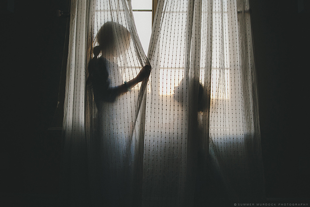 children playing in curtains photo by Summer Murdock
