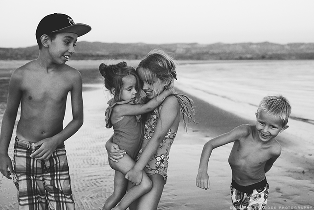 children portrait on beach photo by Summer Murdock