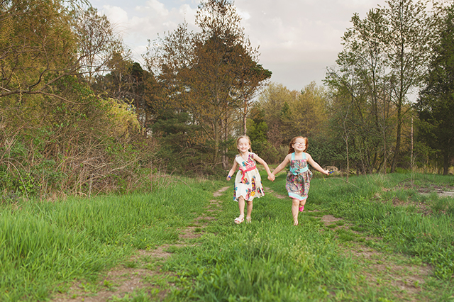 children running together along a path pic