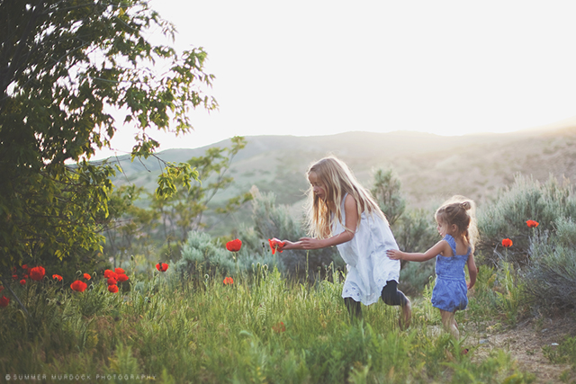 girls picking flowers in field photo by Summer Murdock