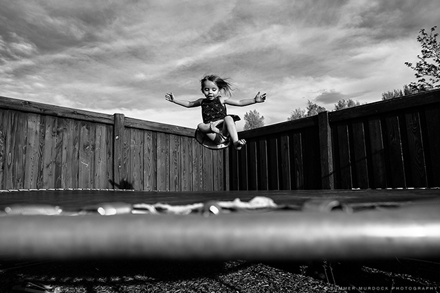 kid jumping on trampoline photograph by Summer Murdock