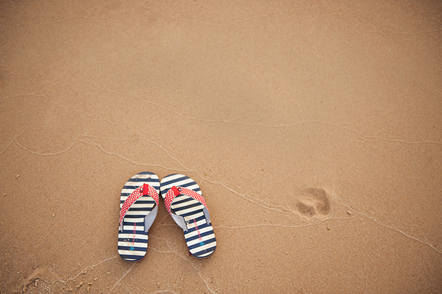 striped flip flops in the sand photograph