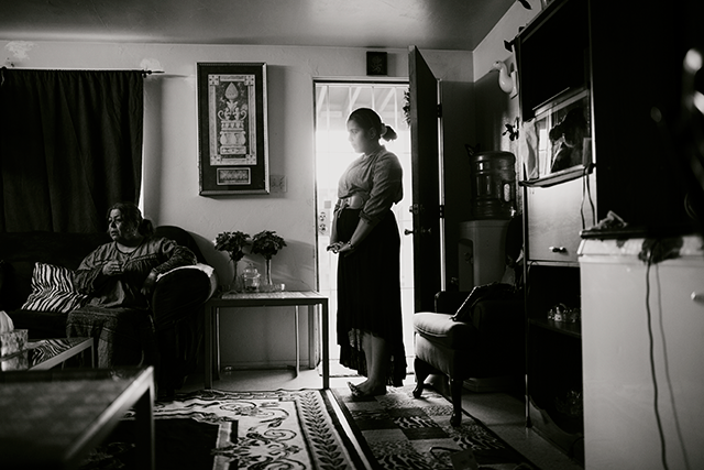 woman standing in doorway photo by Jenna Reich