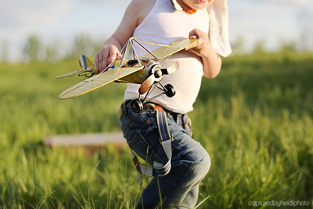 boy holding toy airplane photo by Heidi Hicks