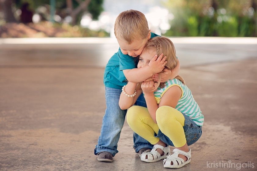 brother and sister hugging photo by Kristin Ingalls